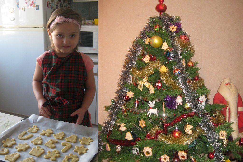 Девочка выкладывает новогоднее печенье на форму для выпечки