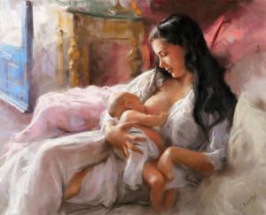 Мать кормит грудью младенца