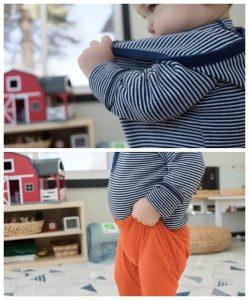 ребёнок натягивает штаны и кофту