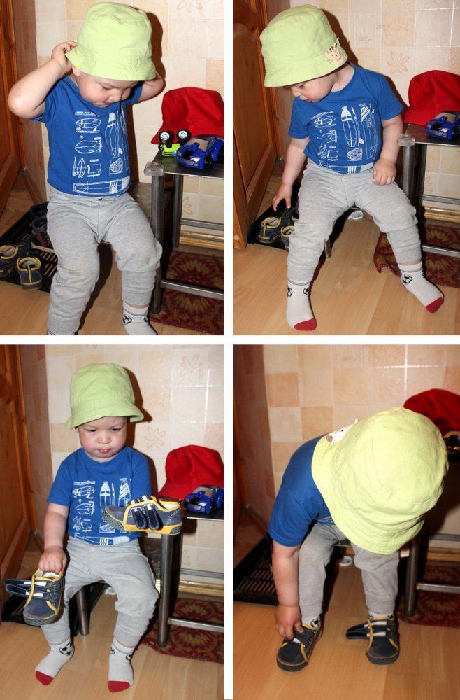Ребёнок надевает панамку и обувается